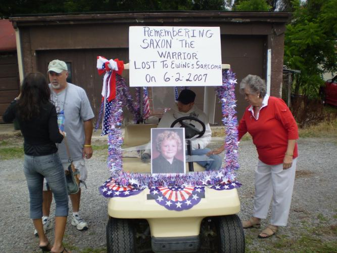 His beloved golf cart  & the 1st remebrace in 4th July parade